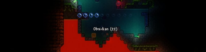 Mining Obsidian in Terraria, which is required to make Hellstone Bars for crafting gear